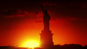Statue of liberty at sunrise stock video