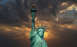 The Statue of Liberty at sunrise stock photography
