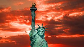 The Statue of Liberty at sunrise royalty free stock images