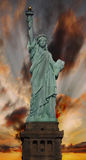 Statue of Liberty at sunset. Full length Statue of Liberty at sunset royalty free stock photos