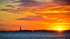 Statue of Liberty at sunset in New York Royalty Free Stock Photos