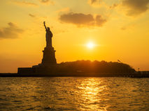 The Statue of Liberty at sunset Royalty Free Stock Photo