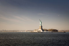 Statue of Liberty at sunset from the sea Royalty Free Stock Photo