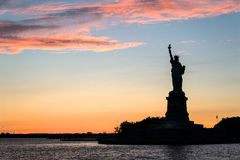 Statue Of Liberty Sunset Silhouette Stock Photos