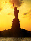 The Statue of Liberty at sunset Royalty Free Stock Images