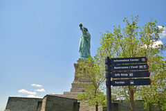 Statue of Liberty with trees and direction Stock Photo