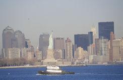 Statue of Liberty and tugboat post 9/11 without World Trade Towers, Manhattan skyline, NY Stock Images