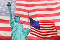 Statue of Liberty and Two American flag Stock Photo