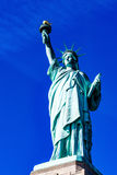 Statue of Liberty under Blue Sky Stock Images
