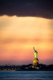 Statue of Liberty under a dramatic sunset light Stock Images