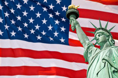 Statue of Liberty, United Stated flag background, New York Royalty Free Stock Photo
