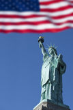 Statue of Liberty and the US Flag, New York City, New York, USA Royalty Free Stock Photography