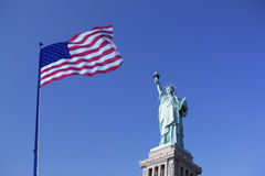 Statue of Liberty and the US Flag, New York City, New York, USA Royalty Free Stock Photos