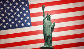 Statue of liberty on USA flag Stock Photos