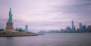 The statue of Liberty. View of the statue of liberty with Manhattan in New York City, USA Royalty Free Stock Photos