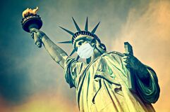 Statue of Liberty wearing a surgical mask. New coronavirus, covid-19 in New York and USA epidemic concept
