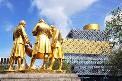 Statue and library, Birmingham. Statue of Matthew Boulton along with James Watt and William Murdoch by William Bloye with the New Library to the rear, Broad Royalty Free Stock Photos