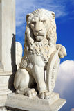Statue of lion on a background of blue sky Royalty Free Stock Photo