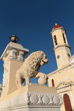 Statue of a Lion and belltower Royalty Free Stock Image