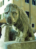 Statue of lion with book Stock Photography