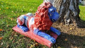 Lion. Statue of a lion with the british flag painted on it Royalty Free Stock Photo