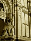 Statue of lion and the church Royalty Free Stock Photography