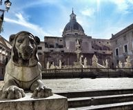 Statue of a lion in the foreground near the Plaza Pretoria to Palermo. Palermo. Sicily. Italy. royalty free stock images