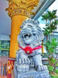 a statue of a lion in front of the hotel stock images