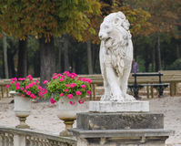 Statue of lion in Gardens of Versailles royalty free stock image