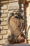 Statue of a lion holding a historic crest in front of the Mdina gate, the former historic capital city of Mdina.  Royalty Free Stock Photography
