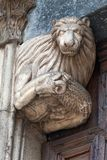 Statue of a Lion holding a Lamb. Monza Cathedral was erected in the mid-14th century by Matteo da Campione Stock Photography