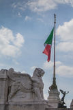 Statue of a Lion and italian flag, Rome, Italy Stock Image