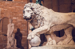 Statue of a lion at the Loggia dei Lanzi royalty free stock image