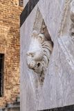 Statue of a lion`s head in marble