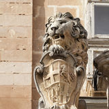 Statue of lion with symbol of Mata ic capital city Valletta Stock Image