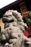 Statue lion before temple Stock Photos