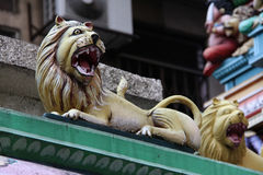 Statue of lion. Traditional decorative statue of open mouth lion from hindu temple  Sri Mahamariamman close up Malaysia Kuala Lumpur Royalty Free Stock Image