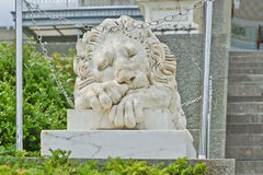 Statue of lion at the Vorontsov Palace facade in the resort town of Alupka. This palace is a tourist attraction of the Crimea. Royalty Free Stock Images