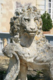 The statue of a lion was installed in the courtyard of a castle in France Royalty Free Stock Image