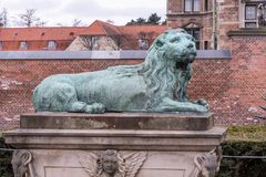 A statue of a lion, which guards the bridge over the moat leading to Rosenborg Castle royalty free stock photography