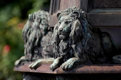 Statue of lions at cemetery in Milan Royalty Free Stock Photos