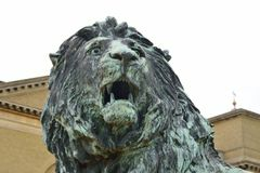 Statue of Lions Head with stately home royalty free stock image