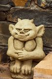 statue of a little imp from a yellow stone royalty free stock images