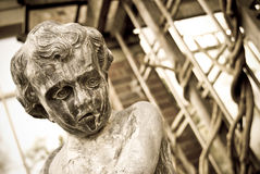 Statue of a little sad boy Stock Photo