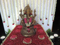 Statue of Lord Ganesha, decorated with flowers Royalty Free Stock Images
