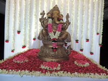 Statue of Lord Ganesha, decorated with flowers Stock Images