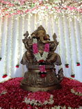 Statue of Lord Ganesha, decorated with flowers Stock Photos