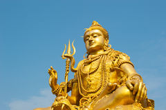Statue of Lord Shiva. With blue sky background Royalty Free Stock Photo