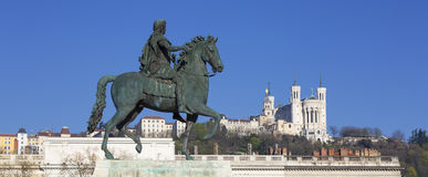 Statue of Louis and Basilique Fourviere on a background Stock Photography