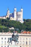 Statue of Louis XIV and basilica. In Lyon city Royalty Free Stock Photography